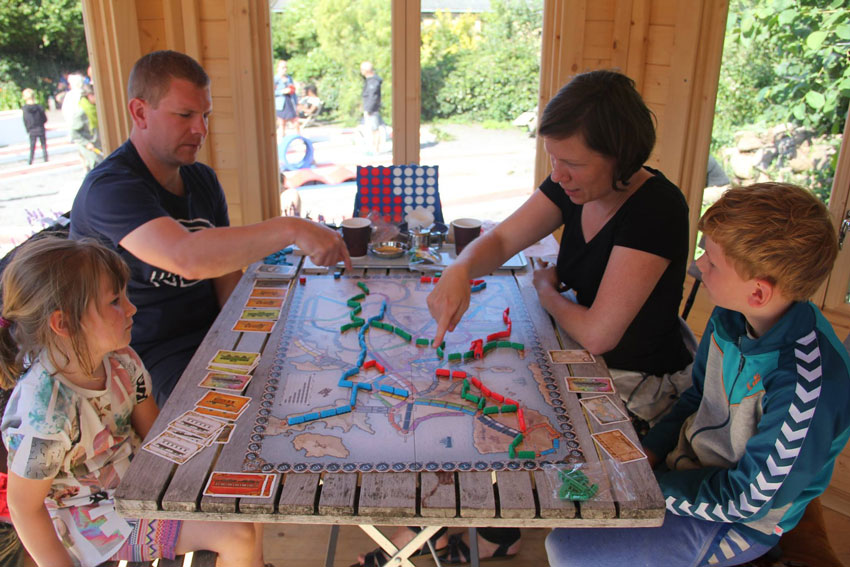 family playing a boardgame